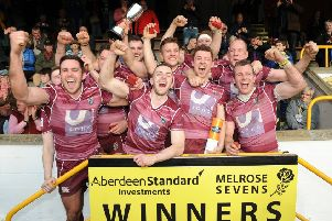 The victorious Watsonians side celebrate with the trophy after their superb win in the final against hosts Melrose on Saturday. Picture: Fotosport