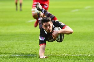 Sam Hidalgo-Clyne dives over for his try, one of eight scored by Edinburgh on Saturday. Picture: SNS/SRU