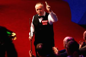 John Higgins celebrates after defeating Thepchaiya Un-Nooh. Picture: Getty