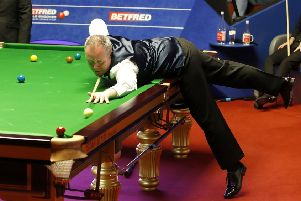 John Higgins poised to pot a red against Judd Trump. Picture: Martin Rickett/PA Wire