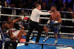 Tony Bellew is sent to a neutral corner after knocking down David Haye on his way to a victory in five rounds at the O2 Arena in London on Saturday evening. Picture: Getty.