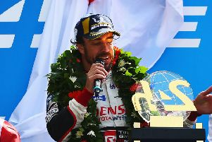 Fernando Alonso on the podium at Le Mans after his Toyota team won for the first time. Picture: Getty.