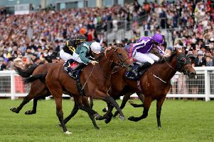 Merchant Navy (right) ridden by Jockey Ryan Lee Moore wins the Diamond Jubilee Stakes. Picture: PA.