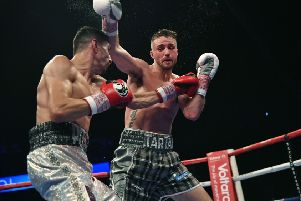 Josh Taylor goes on the offensive against Viktor Postol. Picture: SNS Group