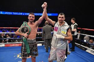 Josh Taylor celebrates after defeating Viktor Postol (right). Picture: Rob Casey/SNS