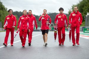 Ferrari driver Sebastian Vettel, centre, inspects the racetrack ahead of Sunday's Austrian Grand Prix at the Red Bull Ring in Spielberg. Picture: AFP/Getty