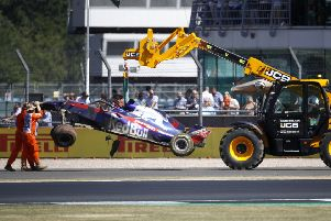 Brendon Hartley's Toro Rosso car is removed from the track. Picture: Martin Rickett/PA Wire