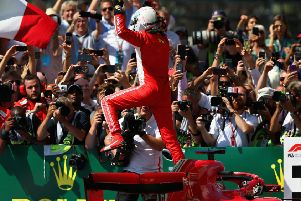 Sebastian Vettel leaps out of his car to celebrate victory in the British Grand Prix at Silverstone. Picture: Getty Images