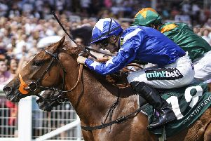 Harry Bentley riding Ginger Nut (blue) win The Weatherbys Super Sprint Stakes at Newbury. Pic: Alan Crowhurst/Getty Images