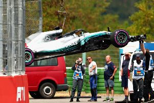 The car of Lewis Hamilton is removed from the circuit after stopping during qualifying. Pic: Dan Istitene/Getty Images