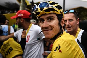 Tour de France winner Great Britain's Geraint Thomas wearing the overall leader's yellow jersey smiles after the 21st and last stage of the 105th edition of the Tour de France cycling race between Houilles and Paris Champs-Elysees. Picture: MARCO BERTORELLO/AFP/Getty Images.