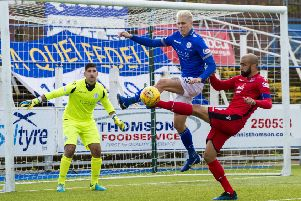 Ross County's Liam Fontaine competes with Lyndon Dykes. Pic: SNS/Sammy Turner