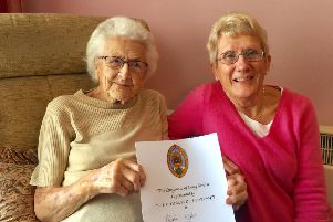 Sheila Wyles with her long-service award, and above with her husband, Albert, who died in the 1960s. Picture: contributed