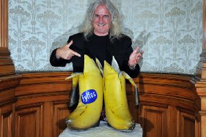 Sir Billy Connolly and his 'big banana boots' (Picture: Robert Perry)
