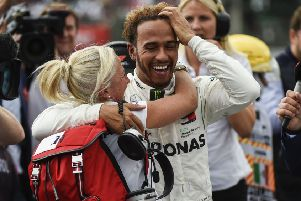 Despite his in-race moans, Lewis Hamilton was all smiles afterwards. Picture: AFP/Getty.