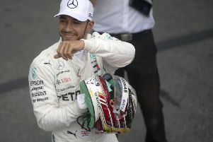 Lewis Hamilton celebrates after taking pole position for the Brazil Grand Prix. Pic: Mauro Pimentel / AFP/Getty