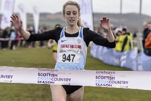 Jemma Reekie crosses the line to win the Scottish Cross Country Championships at Lanark. Picture: Bobby Gavin/scottishathletics