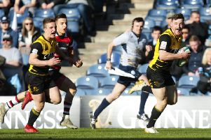 Melrose's George Taylor runs through for a try in last season's Scottish Cup final. Picture: Graham Stuart/SNS