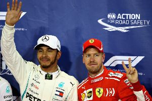 Pole position qualifier Lewis Hamilton celebrates with third place Sebastian Vettel. Pic: Charles Coates/Getty Images