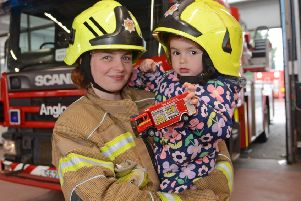 Jessica with her mum Leanne Hamilton pictured at the Toll Cross fire station. Picture: Jon Savage/TSPL