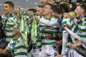 Celtic captain Scott Brown lifts the trophy. Picture: SNS