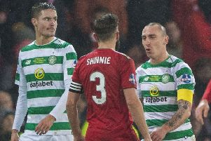 Celtic's Scott Brown, right, exchanges words with Aberdeen's Graeme Shinnie. Picture: SNS