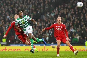 Gary Mackay-Steven clashes heads with Celtic's Dedryck Boyata, with both players suffering injuries. Picture: SNS