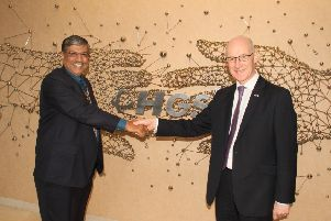 HGS's global chief executive Partha DeSarkar shakes hands with Deputy First Minister John Swinney. Picture: Contributed