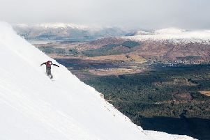 Snowboarder Rhys Crilley spreading his wings on Winger Wall at Nevis Range PIC: Stevie McKenna