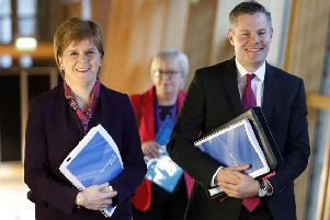 Nicola Sturgeon and Derek Mackay on their way to the debate on the Scottish Government's draft spending and tax plans for 2019-20. Picture: PA