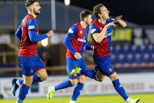 Tom Walsh celebrates his goal for Inverness. Pic: SNS/Roddy Scott