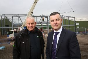 Billy Wilson, director at Jas P Wilson, with Stephen Owens, relationship director at the bank. Picture: Chris Watt