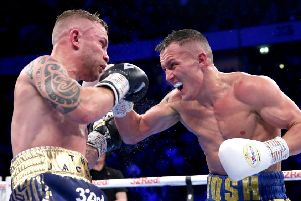 Josh Warrington lands a punch on Carl Frampton during Saturday's title fight.''Picture: Getty
