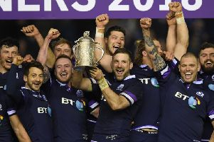 John Barclay raises the Calcutta Cup amid his jubilant players after Scotland beat England in February.''Photograph: Shaun Botterill/Getty Images
