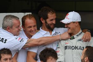 Michael Schumacher with his Mercedes team at the 2012 Brazilian Grand Prix, his final race. Picture: AFP/Getty.