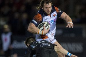 Edinburgh's Pierre Schoeman is tackled by Glasgow Warriors' George Horne. Picture: Bill Murray/SNS