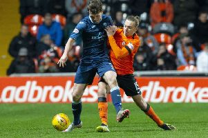 Partick Thistle's James Penrice battles for possession with Aidan Nesbitt of Dundee United at Tannadice on Saturday. Picture: SNS.