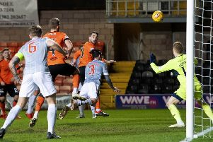 Nicky Clark flashes a header past goalkeeper Lee Robinson to move Dundee United to within three points of top spot in the Championship.  Photograph: Alan Harvey/SNS