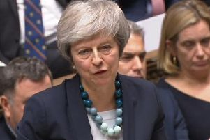 Prime Minister Theresa May has survived a bid to force her from office