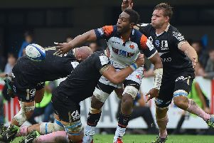 Viliame Mata offloads the ball during Edinburgh's defeat by Montpellier in the Pool 5 opener. Picture: AFP/Getty