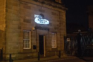 Billy Letford's Love Letter to Europe is projected onto the side of Leith Library as part of Message From The Skies