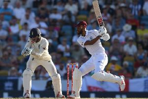 West Indies batsman Roston Chase plays a shot as England wicketkeeper Ben Foakes looks on at the Kensington Oval in Barbados. Picture: Shaun Botterill/Getty