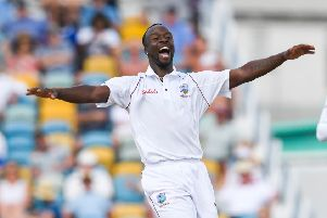 West Indies paceman Kemar Roach celebrates the dismissal of England's Jos Buttler. Picture: Randy Brooks/AFP/Getty