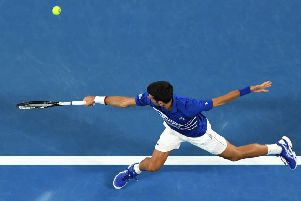 Novak Djokovic hits a return to Lucas Pouille during their men's singles semi-final. Picture: William West/AFP/Getty