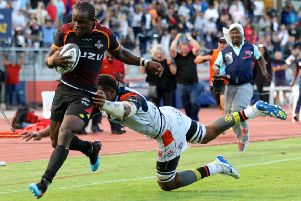 Edinburgh's Viliame Mata can't get to grips with Yaw Penxe as the South African runs through to score the Kings' final try in Port Elizabeth. Picture: Richard Huggard/INPHO/REX/Shutterstock