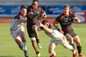 Edinburgh's Chris Dean and George Taylor try to get to grips with Harlon Klaasen of Southern Kings at NMU Stadium in Port Elizabeth on Saturday. Picture: Rex/Shutterstock