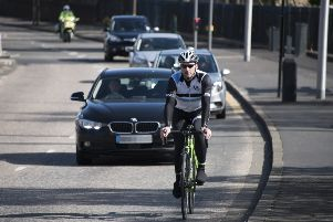 Drivers passing cyclists too close are among the risks they face. Picture: Andrew O'Brien