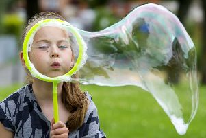 Simple pleasures like blowing bubbles are increasingly being replaced by computers with children aged eight to 11 spending nearly 24 hours a week online (Picture: Ian Rutherford)