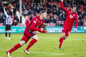Ross County's Billy McKay celebrates after equalising. Pic: SNS/Roddy Scott