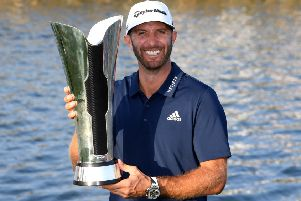 Dustin Johnson celebrates with the trophy after winning the Saudi International at the Royal Greens Golf & Country Club. Picture: Getty